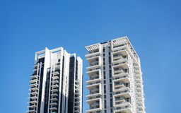 BAT YAM, ISRAEL- MARCH 3, 2018: High residential building against a blue sky in Bat Yam, Israel. BAT YAM, ISRAEL- MARCH 3, 2018: High residential building Stock Photo