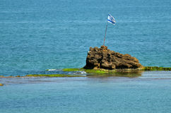 Bat Yam - Israel. The national flag of Israel on-top of the rock Hasela (the rock) Beach, a very famous beach in the resort city Bat Yam , Israel Stock Images