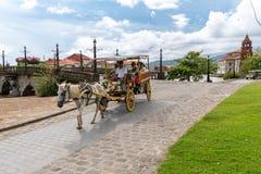 Jun 30,2018 :Tourists on a wagon at Las casas filipinas,Bataan, Philippines. Bataan, Philippines - Jun 30,2018 :Tourists on a wagon at Las casas filipinas Stock Photo