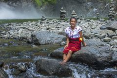 Girl from Ifugao ethnic minority in the Philippines. BATAD, PHILIPPINES - MAY 02 : Girl from Ifugao Minority near a waterfall in Batad the Philippines on May 02 Royalty Free Stock Photography