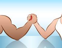 Bataille de bras de fer de femme d'homme des sexes Photo libre de droits