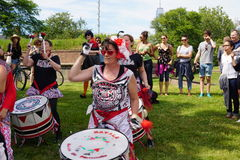 Batala At The 2015 Figment Festival 40. BatalaNYC is an international music group that plays a style of samba drumming, called samba reggae which originates in stock photo