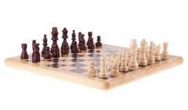 Batalla del ajedrez en el tablero de madera Fotos de archivo libres de regalías