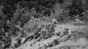 Batalla pesada en la acción con blanco y negro Fotografía de archivo libre de regalías