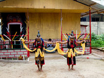 BATAM, INDONESIA - DECEMBER 7, 2012: Local citizens performing acts in traditional attire. During the day Royalty Free Stock Images