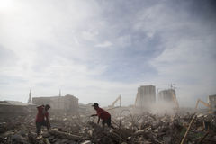 Batang Village Demolition at North Jakarta. Jakarta, 11 April 2016 : Scavenger looling for iron from the ruin building. Jakarta Government starting the Royalty Free Stock Photography