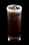 Batanga drink rimmed with salt isolated on black. Batanga is a Mexican drink that contains tequila and cola and is rimmed with salt. Isolated on black Stock Image