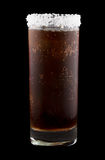Batanga drink rimmed with salt isolated on black Royalty Free Stock Images