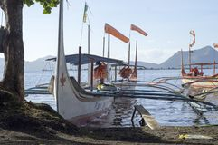 Tourist Boat Parked at Lake-shore that cater to inter island travelers. Batangas, Philippines – December 25, 2015: Tourist Boat Parked at Lake-shore that stock photos