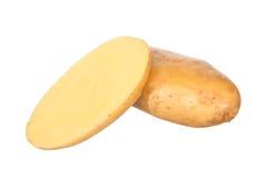 Batata cortada isolada no branco Imagem de Stock