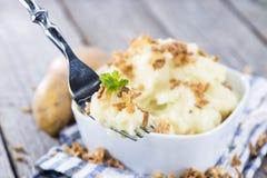 Batata triturada com cebolas fritadas Fotos de Stock