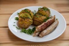 Batatas com salsichas Fotos de Stock Royalty Free