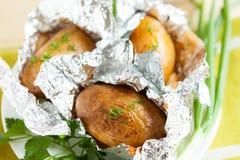 Batatas cozidas na folha com ervas Imagens de Stock Royalty Free