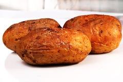 Batatas de revestimento Fotografia de Stock