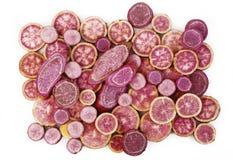 Batatas doces roxas no branco Fotos de Stock Royalty Free