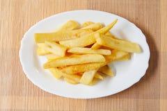 Batatas fritadas fotografia de stock royalty free