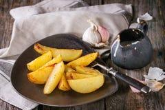 Batatas fritadas com molho Fotografia de Stock