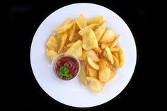 Batatas fritadas com molho de tomate Imagem de Stock Royalty Free
