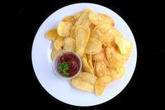 Batatas fritadas cortadas com molho de tomate Imagens de Stock Royalty Free