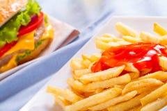 Batatas fritas com ketchup Foto de Stock Royalty Free