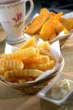 Batatas fritas e Fried Wedges Fotos de Stock