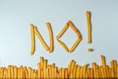 Batatas fritas gordas no fundo branco Fotos de Stock Royalty Free