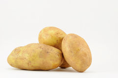 Batatas no branco Fotografia de Stock Royalty Free