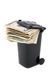 Batch of bank notes in black rubbish bin Stock Image