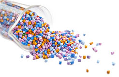 Batch of colorful plastic polymer granules Stock Image