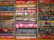 Batch of fabric in a store. Batch of fabrics by multiple colors in a store for sale by linear meter royalty free stock photo