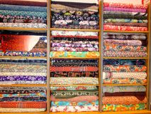 Batch of fabric in a store. Stock Image