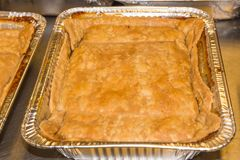 Freshly Baked Peach Cobbler. Batch of freshly baked peach cobbler for sale or serving at a restaurant deli stock photography