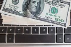 Batch of one hundred dollar bills on keyboard Stock Photo