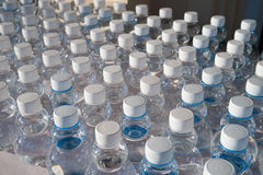 Batch plastic bottles of water. Stock Photography