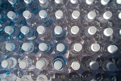 Batch of plastic bottles of water. Stock Images