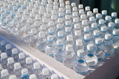 Batch of plastic bottles of water. Royalty Free Stock Photos