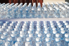 Batch of plastic bottles of water. Royalty Free Stock Images