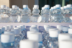 Batch of plastic bottles of water. Royalty Free Stock Photo