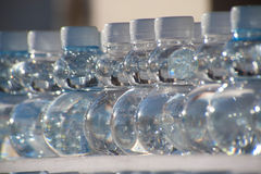 Batch plastic bottles of water. Stock Images