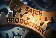 Batch Production on Golden Gears. 3D Illustration. Batch Production on the Mechanism of Golden Cogwheels. Batch Production - Industrial Illustration with Glow Royalty Free Stock Photo