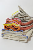 Batch of protective cotton anti-slip gloves for industrial worke Royalty Free Stock Image