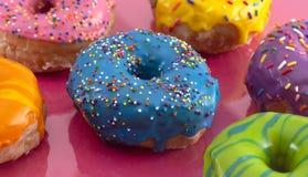 Batch of Rainbow Colored Glazed Donuts. A Batch of Rainbow Colored Glazed Donuts stock photography