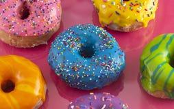 Batch of Rainbow Colored Glazed Donuts. A Batch of Rainbow Colored Glazed Donuts stock photos