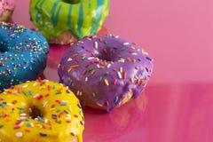 Batch of Rainbow Colored Glazed Donuts. A Batch of Rainbow Colored Glazed Donuts stock image