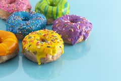 Batch of Rainbow Colored Glazed Donuts. A Batch of Rainbow Colored Glazed Donuts royalty free stock photos
