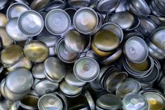 A batch of thick annealed alluminium stamped half-spherical parts. Random piled-up pattern with top-down view.  stock photography