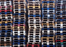 Batch of wooden colourful pallets Stock Images
