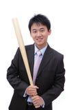 Bate de béisbol de la toma del hombre de negocios con sonrisa cómoda Fotografía de archivo