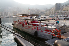 Bateau bus in Monaco . MONACO - JUNE 10, 2010: Ecological electric water bus Bateau bus in a harbour with tourists in Monaco Royalty Free Stock Photo