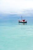 Bateau de l'amour dans l'océan Photographie stock libre de droits